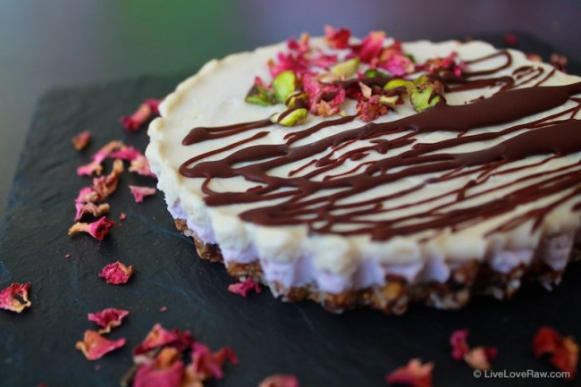 Raw vegan strawberry and white chocolate cream cake with pistachios and rose petals by Anya Andreeva