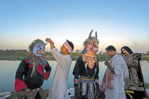 Viashnav monks put on their costumes for a village performance on the Majuli island of Assam. Photos: Sankar Sridhar