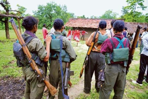 Maoists watch as villagers dance in a forested area of Bijapur district in Chhattisgarh in 2012. Photo: AFP