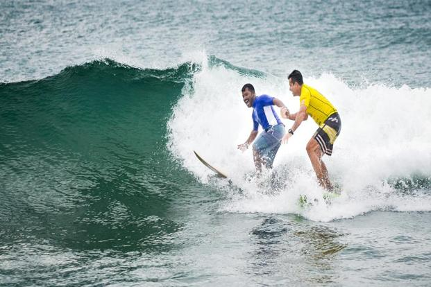 Murthy Megavan (in blue) and Arun Vasu run the Covelong Point surfing school in Kovalam, Tamil Nadu. Photos: Nathan G./Mint