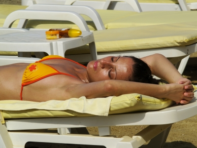 Image of Woman Sunbathing