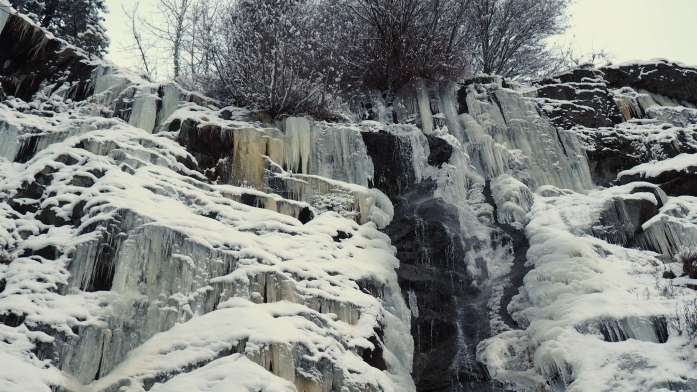 Frozen waterfall close up - rustic cabin in Leavenworth