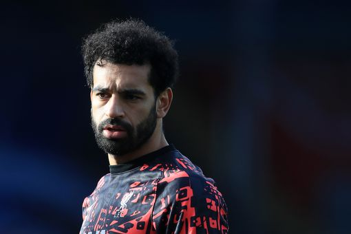 Liverpool's Egyptian midfielder Mohamed Salah warms up ahead of the English Premier League football match between Crystal Palace and Liverpool at Selhurst Park in south London on December 19, 2020. (Photo by Adam Davy / POOL / AFP) / RESTRICTED TO EDITORIAL USE. No use with unauthorized audio, video, data, fixture lists, club/league logos or 'live' services. Online in-match use limited to 120 images. An additional 40 images may be used in extra time. No video emulation. Social media in-match use limited to 120 images. An additional 40 images may be used in extra time. No use in betting publications, games or single club/league/player publications. / (Photo by ADAM DAVY/POOL/AFP via Getty Images)