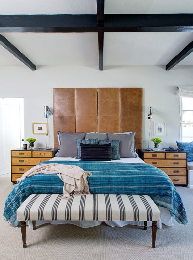 Obsessed with this leather headboard, exposed ceiling beams and blue accents