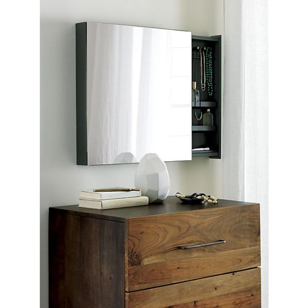 Why just have a mirror, when you can have a mirror that doubles as a jewelry cabinet?!