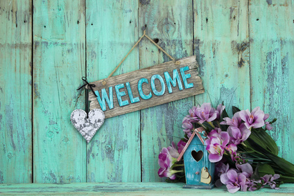 Welcome sign with flowers