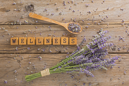 A sprig of lavender and a wooden spoon