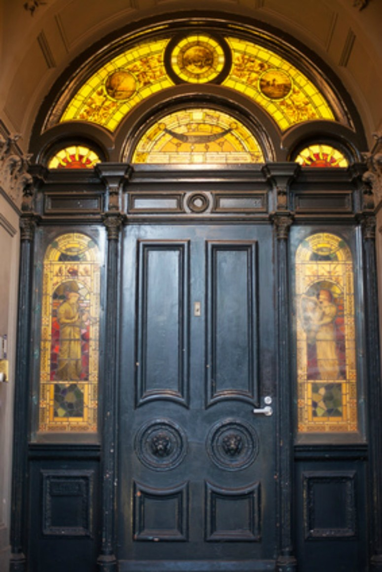 Ornate gothic doorway with stained glass overlays