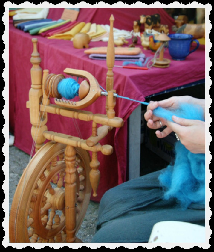 A crafter at her spinning wheel