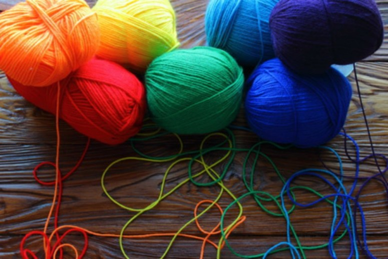 Balls of colorful yarn you can use to knit to make a lasting impression