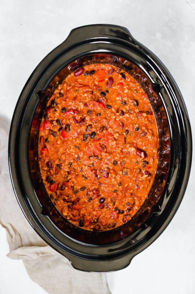 An overhead view of a crockpot filled with homemade turkey chili.