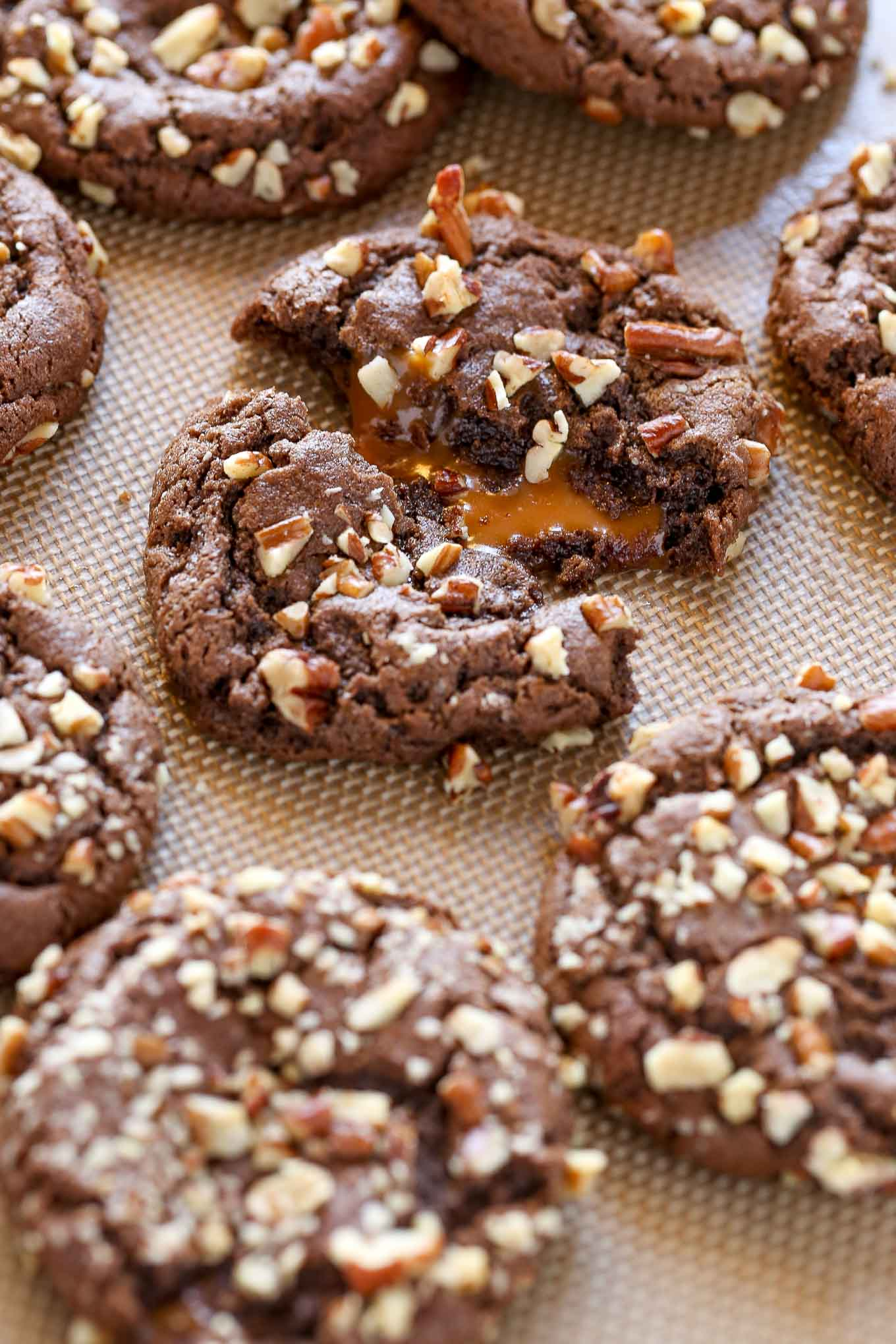 A recipe for easy chocolate cookies stuffed with caramel and coated in chopped pecans. The Chocolate Turtle Cookies are the ultimate dessert!
