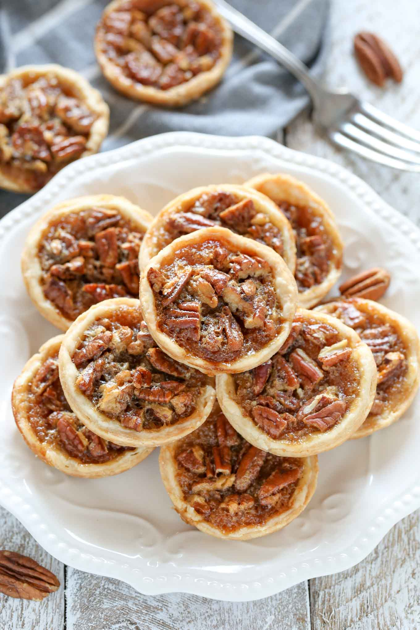 These Mini Pecan Pies are easy to make and can also be made ahead of time. These are the perfect mini treat for Thanksgiving too!