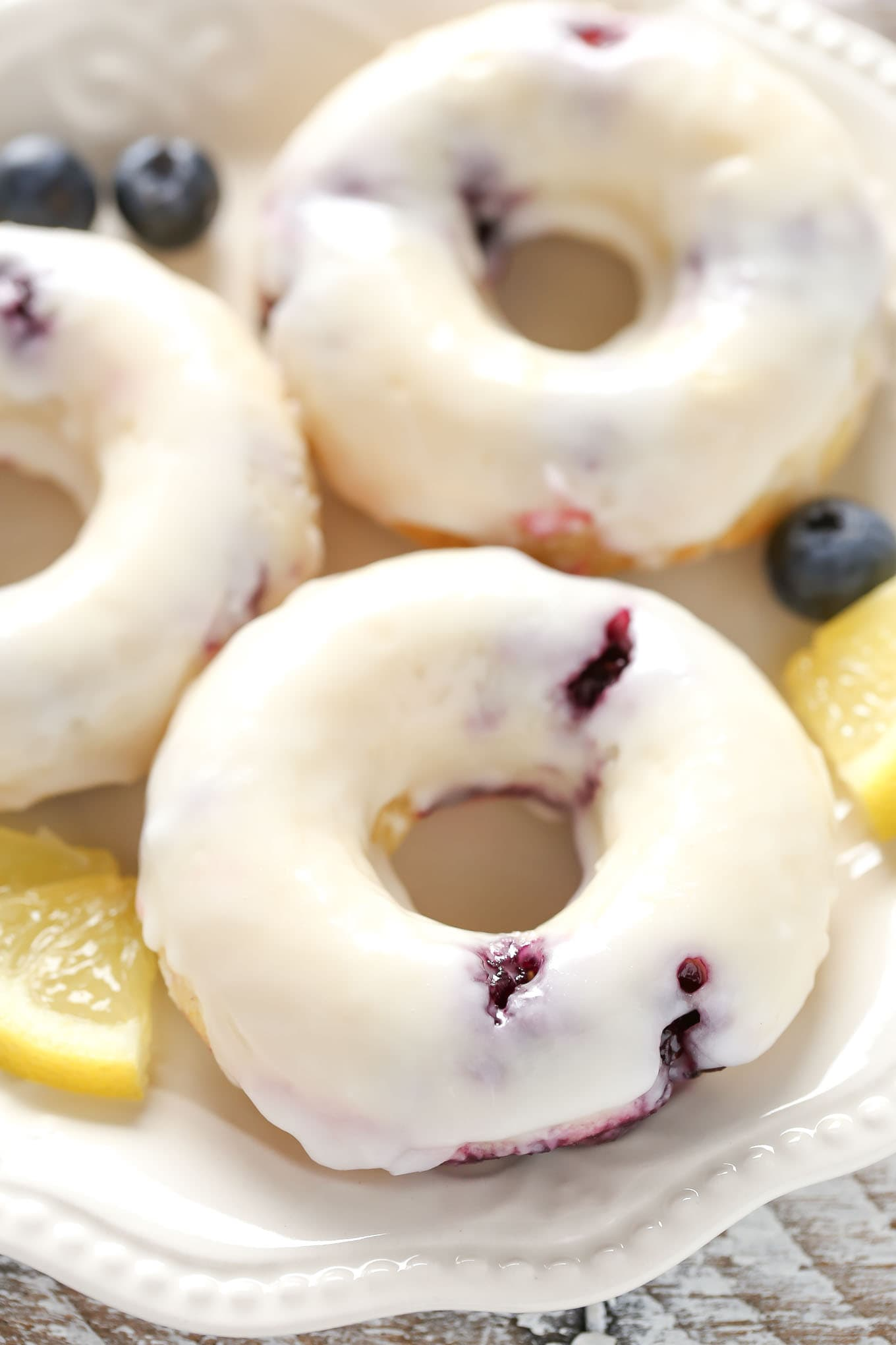 Lemon blueberry donuts topped with a simple two ingredient lemon glaze. These Baked Lemon Blueberry Donuts are incredibly easy to make and perfect for breakfast!
