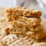 A stack of peanut butter cookies on top of other cookies.