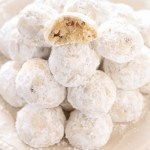 Buttery shortbread cookies filled with pecans and rolled in powdered sugar. These Snowball Cookies are a perfect easy dessert for the holidays!