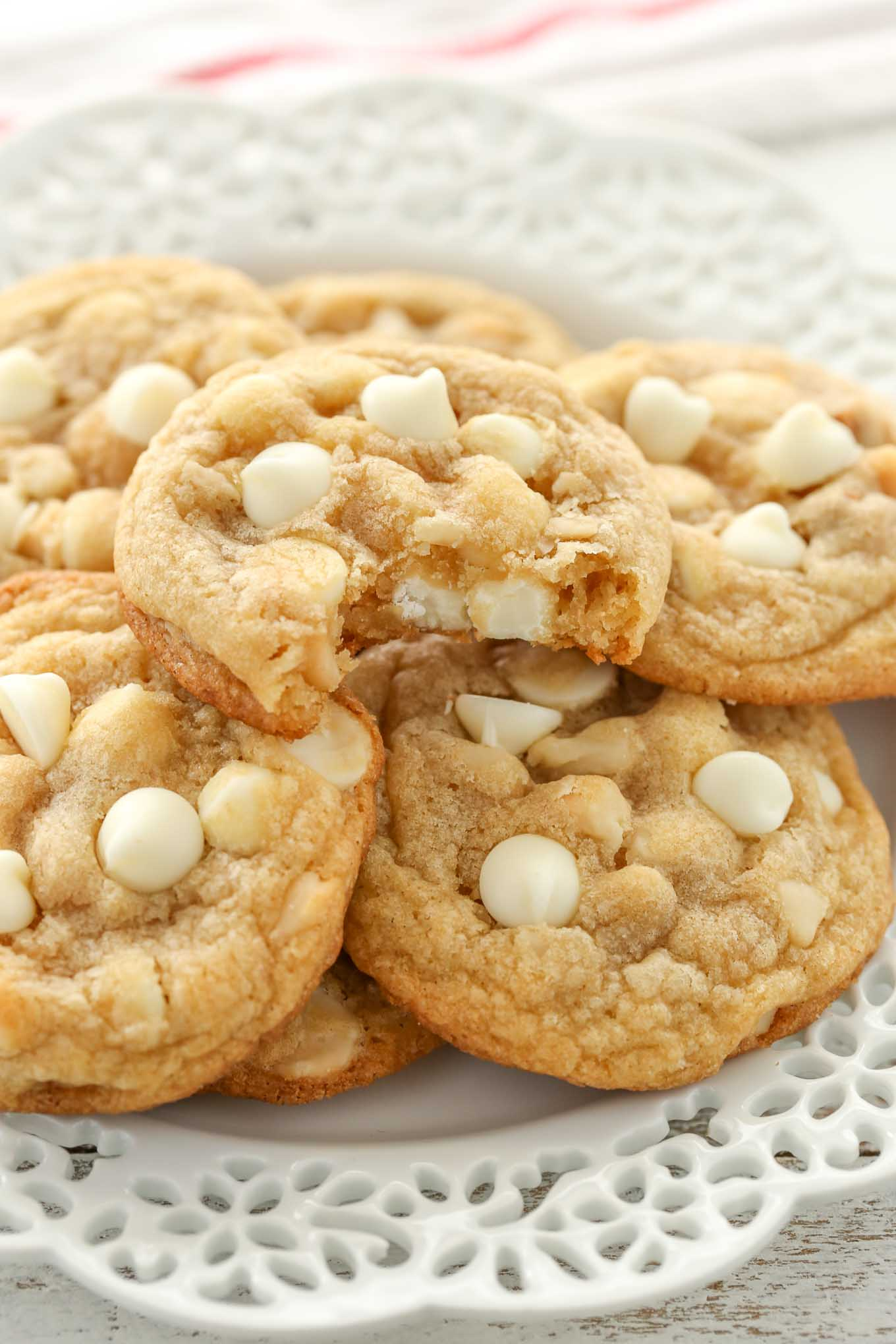 These White Chocolate Macadamia Nut Cookies have slightly crisp edges with soft and chewy centers. Loaded with extra white chocolate chips and macadamia nuts, these are guaranteed to be your new favorite cookie!