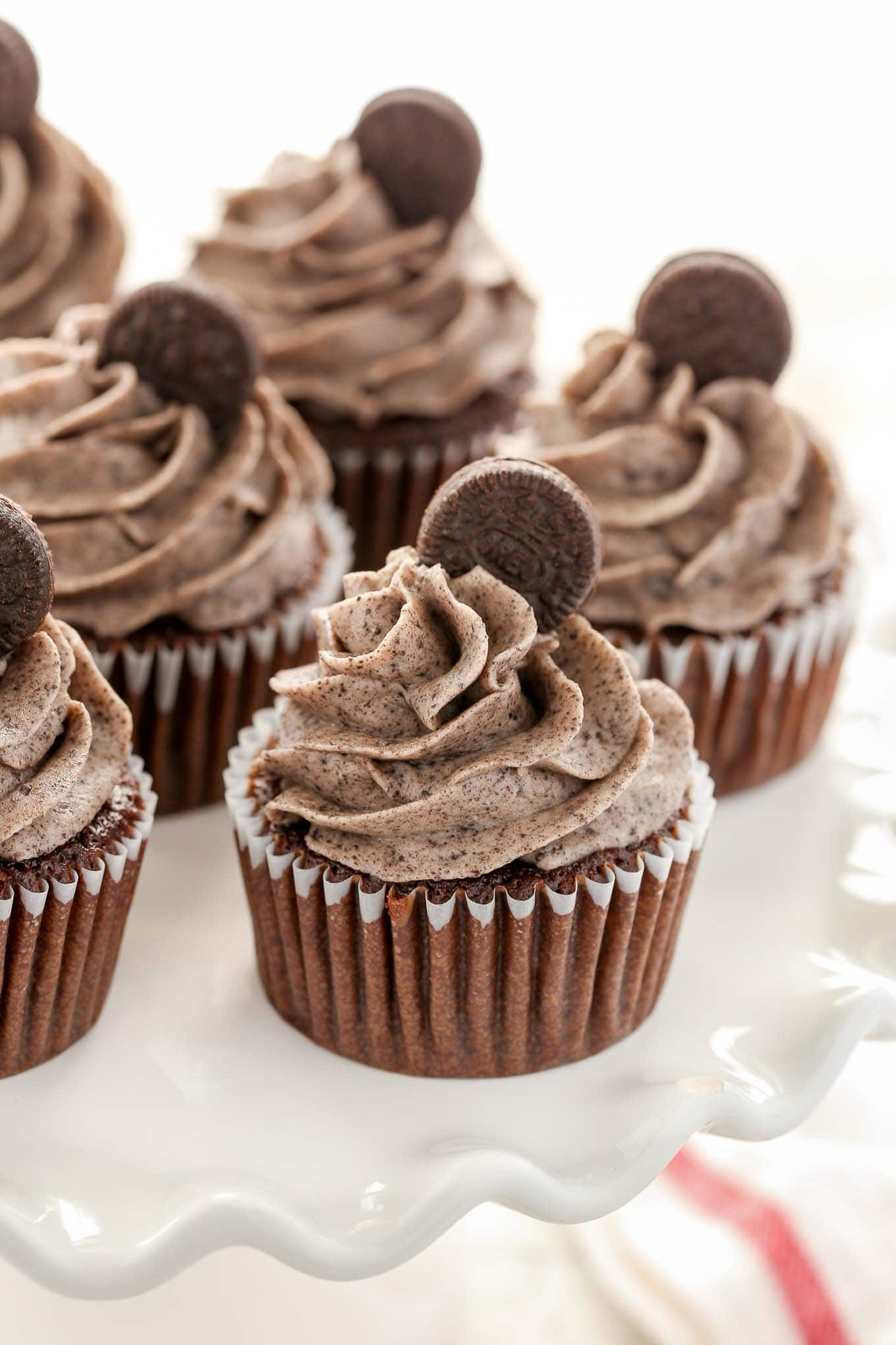 Soft, light, moist chocolate cupcakes topped with an easy Oreo buttercream frosting. These Chocolate Oreo Cupcakes are the ultimate dessert for Oreo lovers!