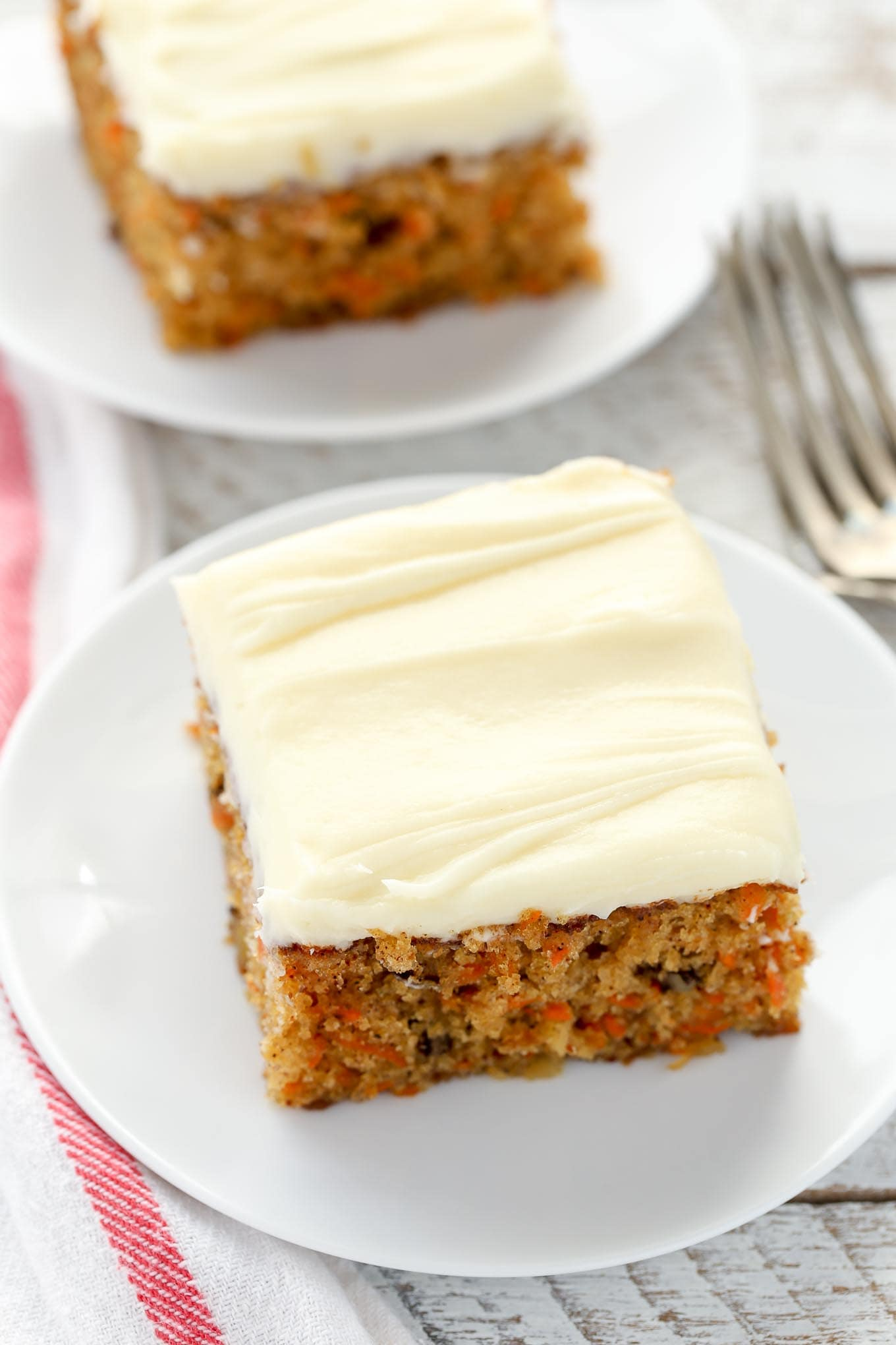 Pineapple Carrot Cake with Cream Cheese Frosting A moist carrot cake filled with crushed pineapple  chopped walnuts  and  topped with an