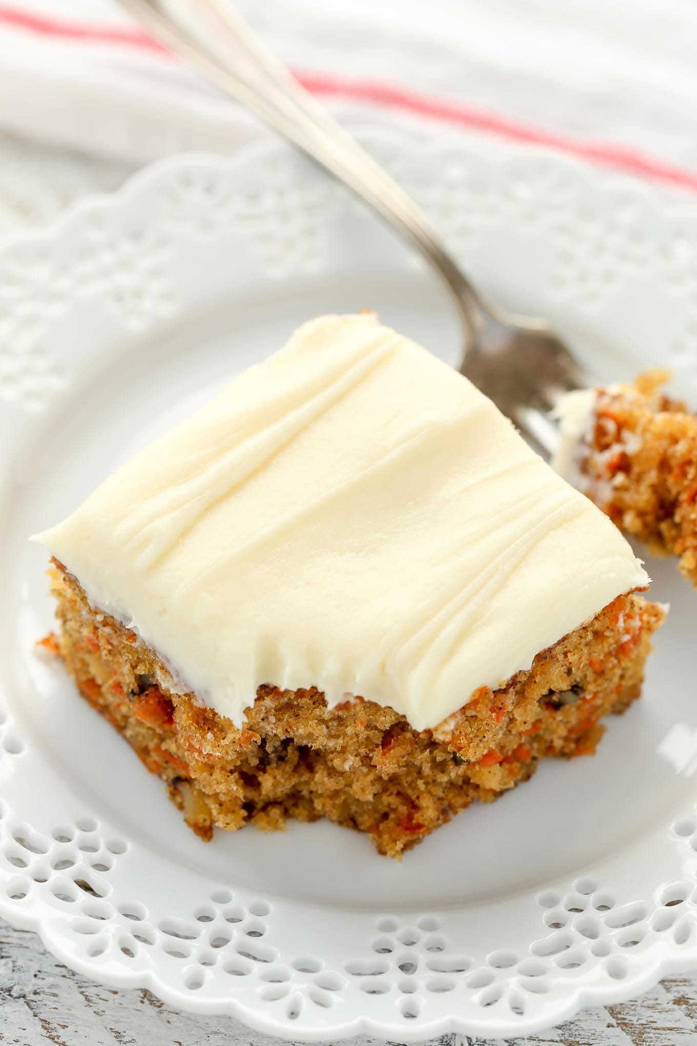 A moist carrot cake filled with crushed pineapple and chopped walnuts and topped with an easy cream cheese frosting. This Pineapple Carrot Cake is perfect for Easter or carrot cake lovers!