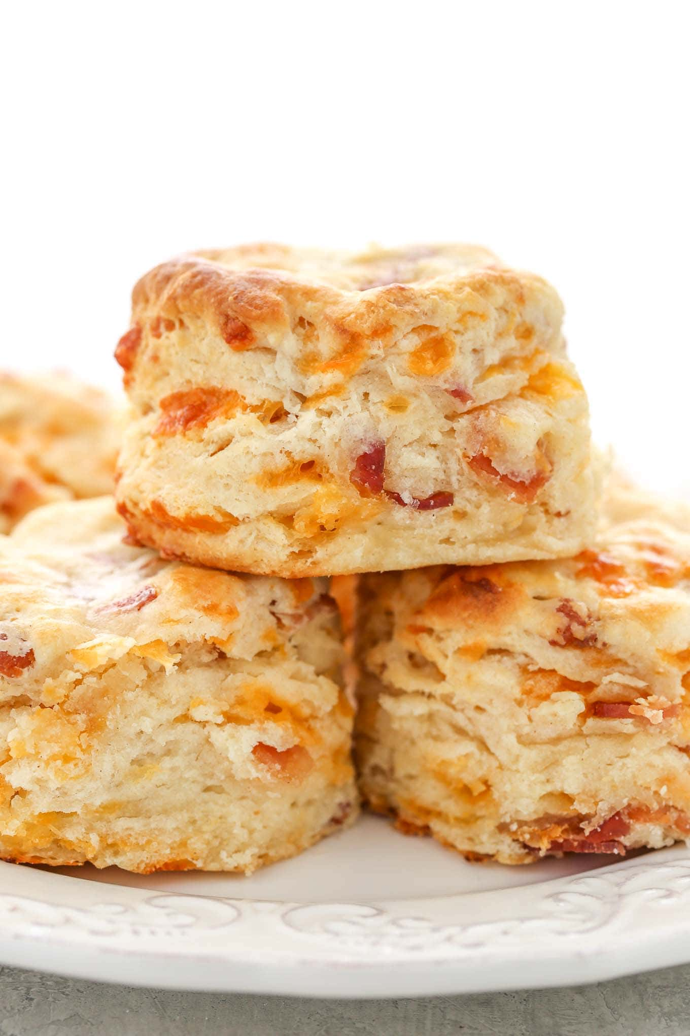 Soft, tall, buttery, and flaky buttermilk biscuits filled with cheddar cheese and bacon. These Bacon Cheddar Biscuits are perfect for breakfast or dinner!
