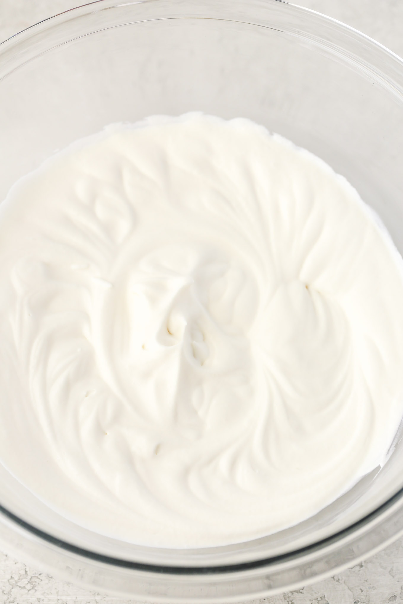 Learn how easy it is to make stabilized whipped cream with this step-by-step tutorial. This whipped cream is perfectly sweet and holds its shape for days!