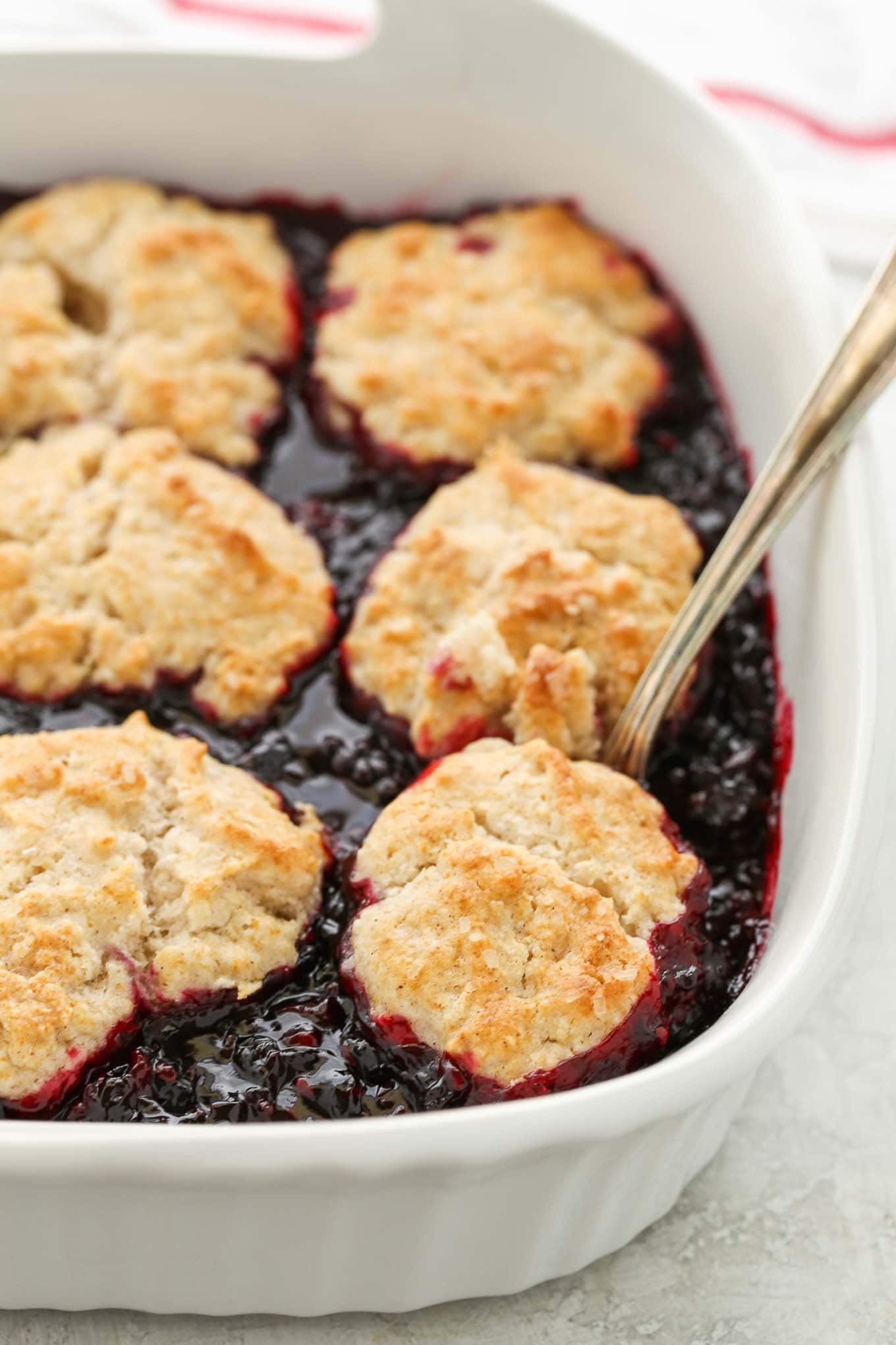 This Blackberry Cobbler features a sweet blackberry filling and a cinnamon sugar biscuit topping. You can even use frozen blackberries in this cobbler so you can enjoy it all year long!