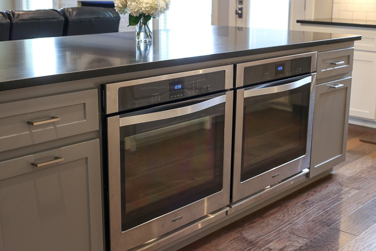 A picture of two single ovens in an island.