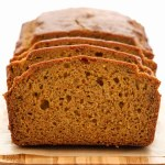 A close-up of a loaf of pumpkin bread that's been sliced.