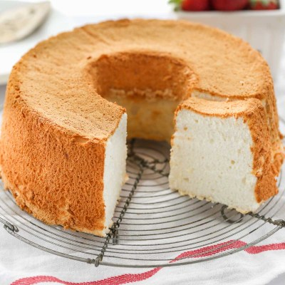 An angel food cake sitting on top of a wire rack.