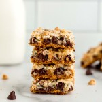 A stack of magic cookie bars on a marble surface.