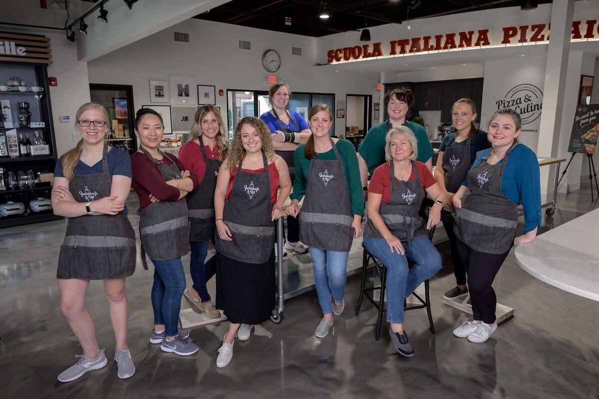 A group of bloggers in aprons.