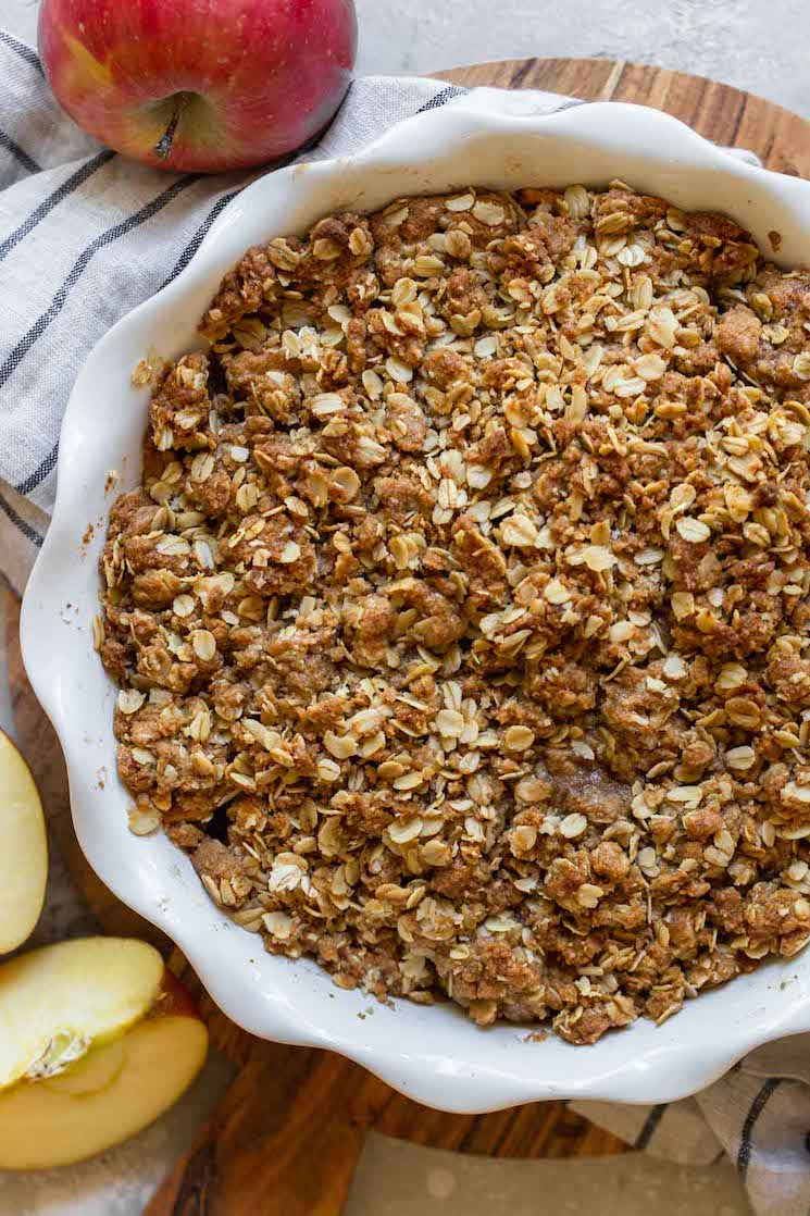 A finished apple crisp in a round baking dish.
