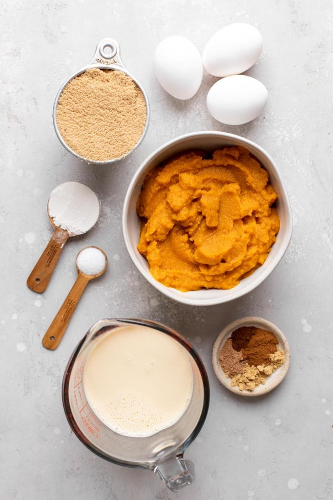 An overhead view of the ingredients needed to make pumpkin pie filling.