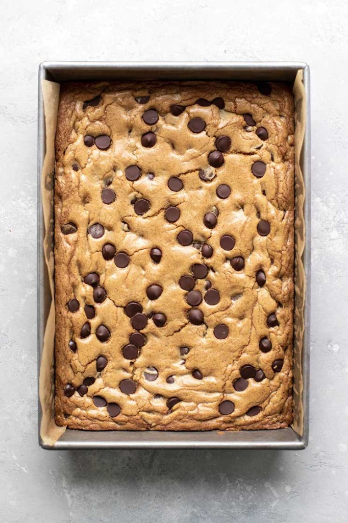A pan of chocolate chip cookie bars, seen from above.