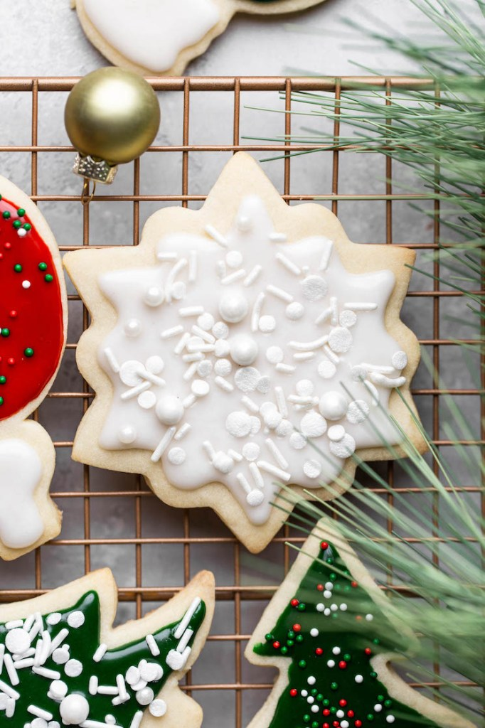 A close up of decorated cookies on a cooling rack.