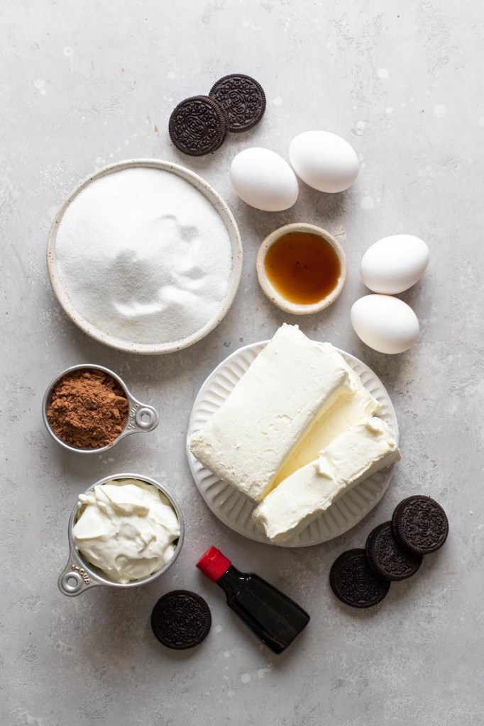 Overhead view of the ingredients needed to make a red velvet cheesecake.