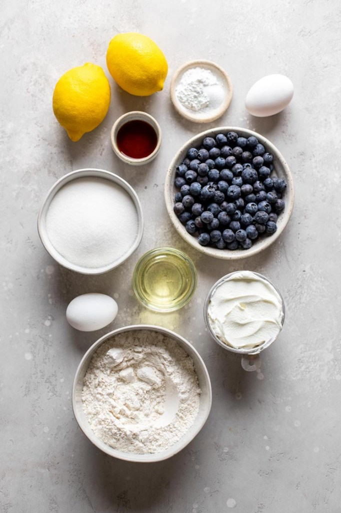 Overhead view of the ingredients needed to make lemon blueberry muffins with sour cream.