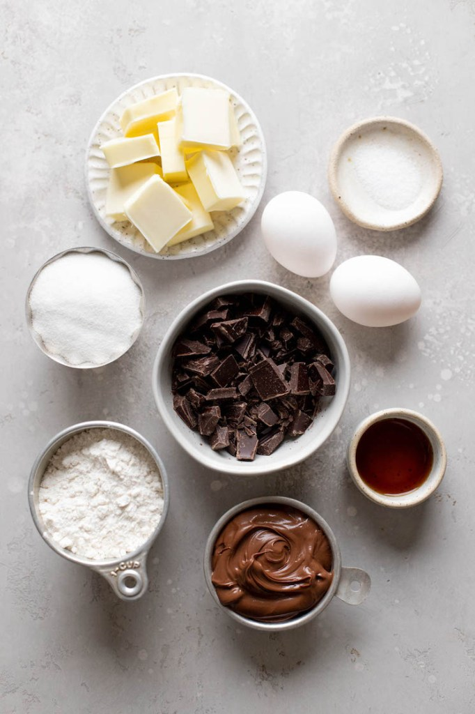 An overhead view of the ingredients needed to make homemade brownies with Nutella.