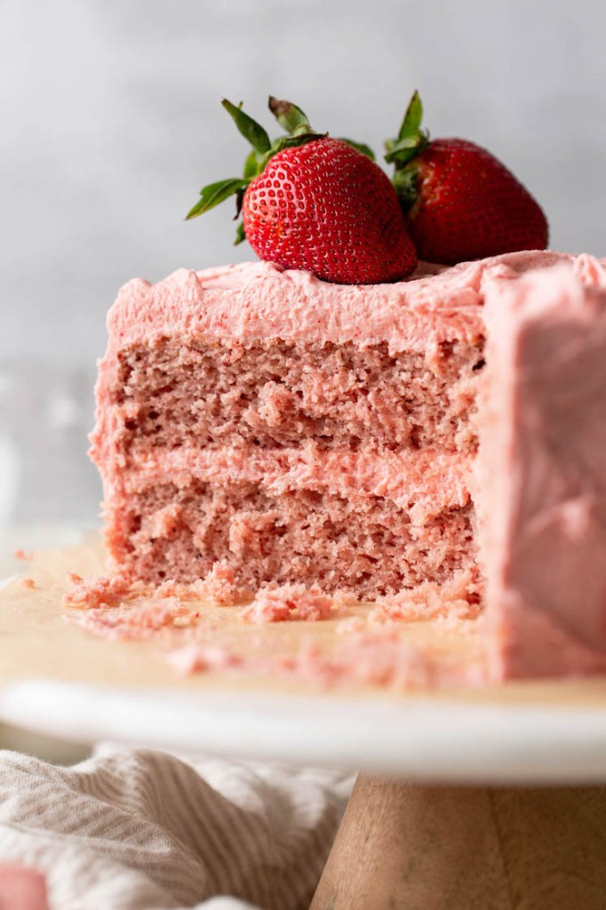 A picture of a sliced strawberry cake showing the inside texture of the cake.
