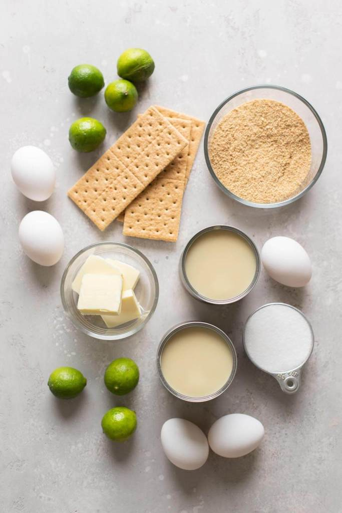 An overhead view of the ingredients needed to make homemade key lime pie.