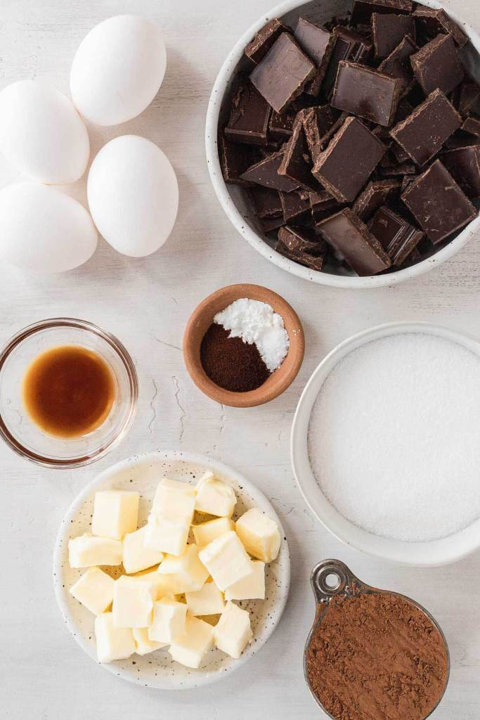 An overhead view of the ingredients needed to make a flourless cake.