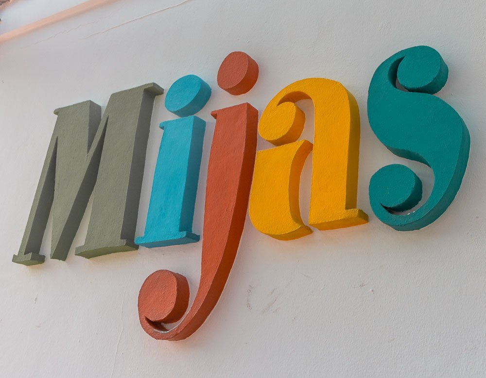 sign of mijas by the tourism building