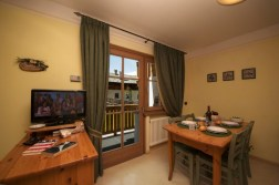 Fully equipped kitchen with dining area and balcony access