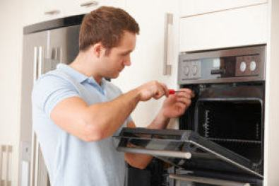 Man fixing kitchen appliances