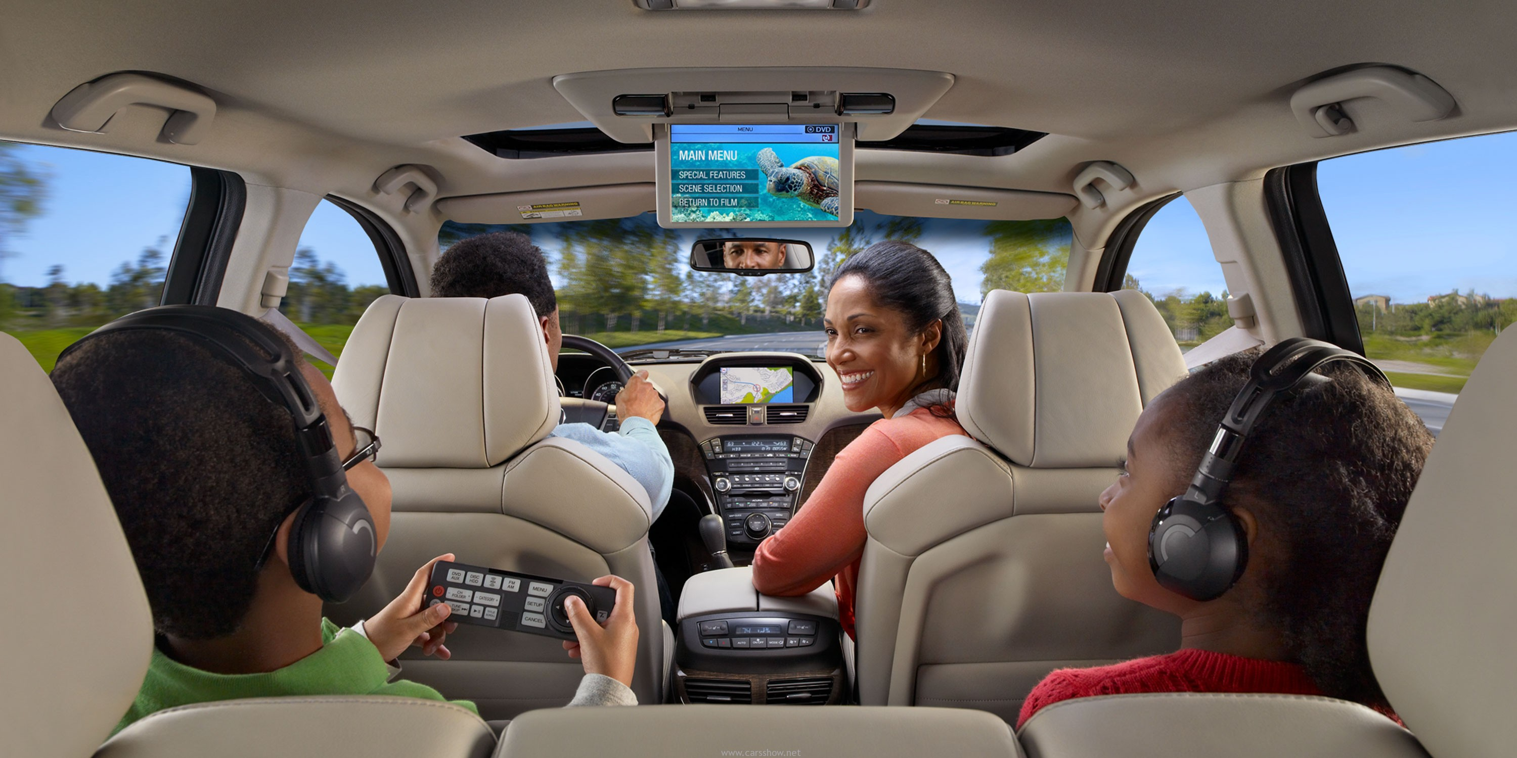 Family Driving Inside A SUV