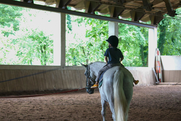 My son taking riding lessons at La Subida