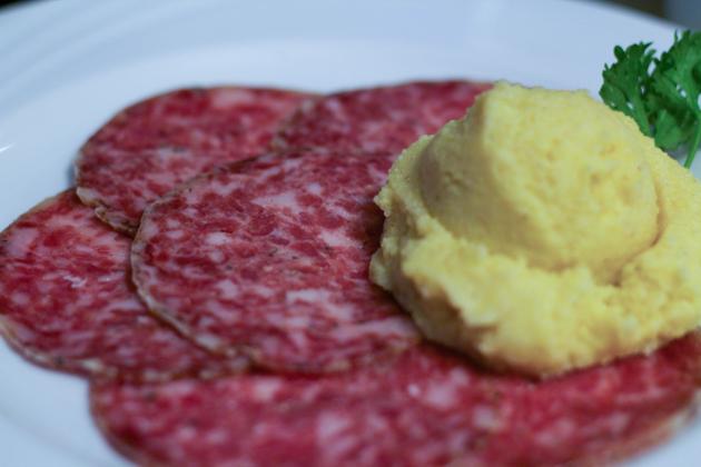 Sopressa sausage with polenta (sopressa con polenta)