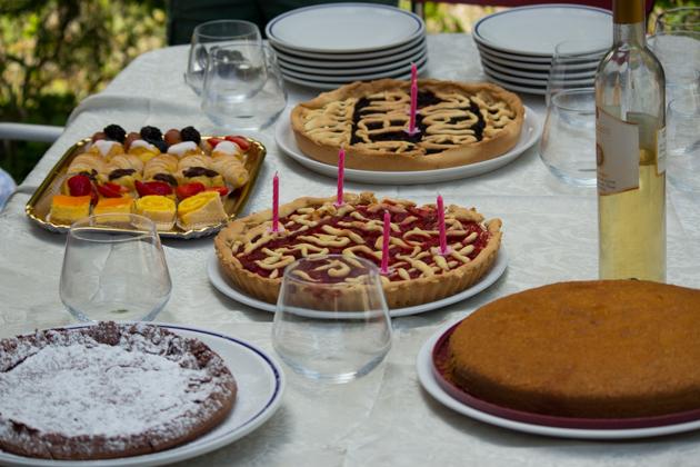 Al fresco birthday celebration with homemade cakes and tarts