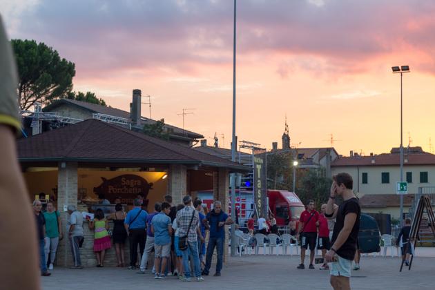 Festival goers queuing for porchetta